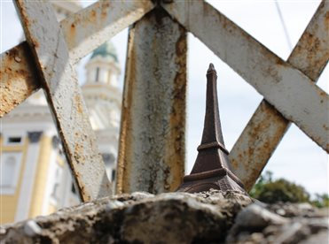 Miniature Eiffel Tower in Uzhhorod is placed  in electric footing of interwar period.